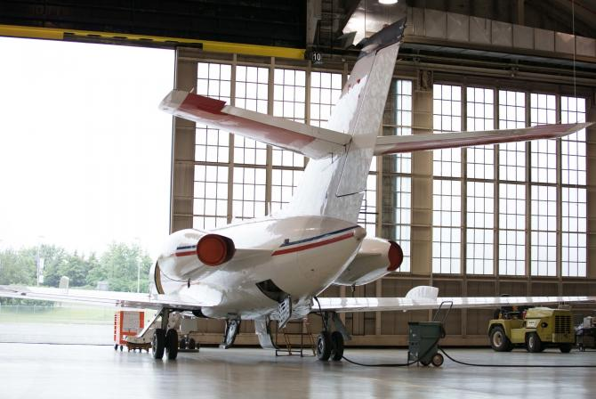 An aircraft about to exit the hangar