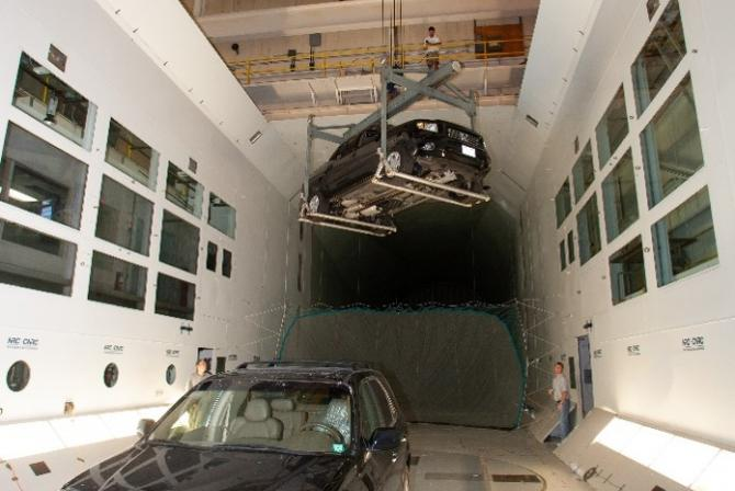 Two trucks being tested in the wind tunnel