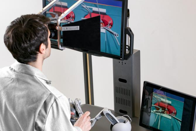 Researcher testing surgical simulator