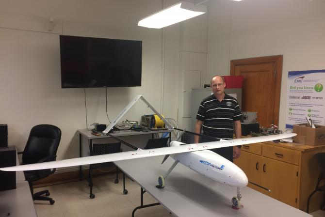 Researcher in the lab with the Unmanned Aerial Vehicle