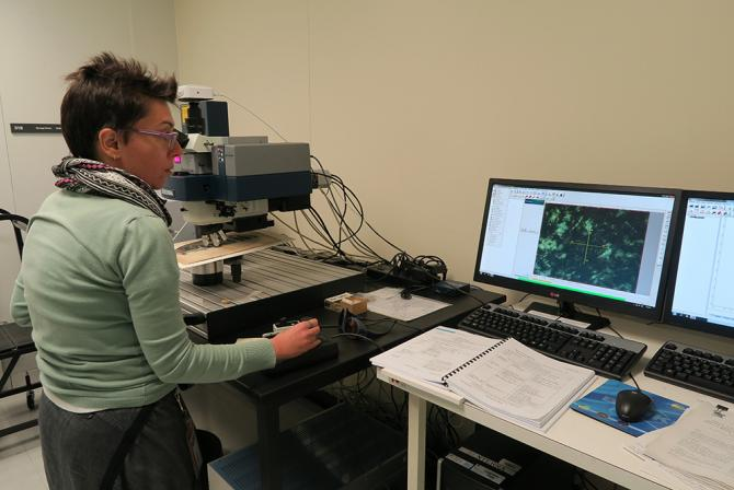 Conservation scientist using the Raman spectrometer for analysis