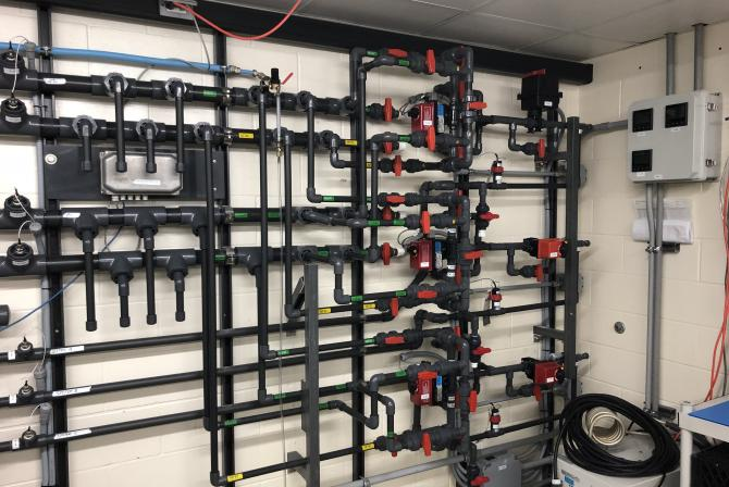 A wall of water supply pipes for research aquariums
