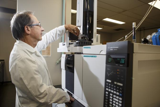 Researcher uses equipment in a lab