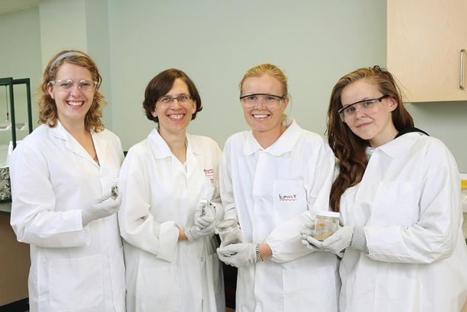 Researchers and student in the laboratory