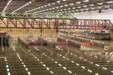 Research infrastructure and fixed structures set up within a large rectangular indoor water basin